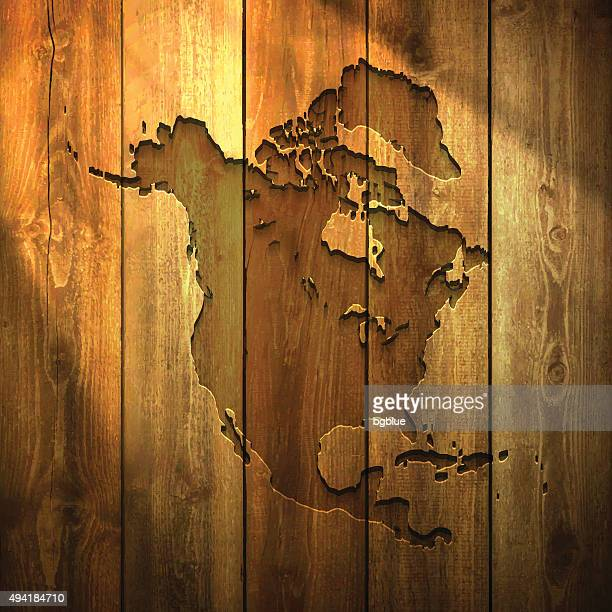 north america map on lit wooden background - central america stock illustrations, clip art, cartoons, & icons