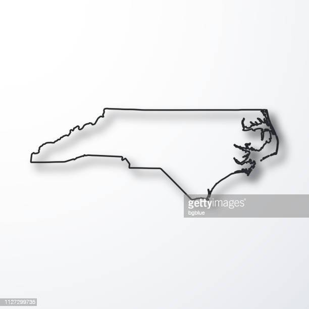 north carolina map - black outline with shadow on white background - north carolina us state stock illustrations