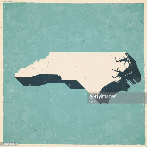 north carolina map in retro vintage style - old textured paper - north carolina us state stock illustrations