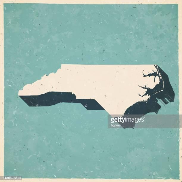 stockillustraties, clipart, cartoons en iconen met north carolina kaart in retro vintage stijl-oude getextureerde papier - north carolina amerikaanse staat