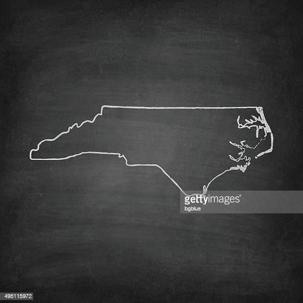 north carolina map on blackboard - chalkboard - north carolina us state stock illustrations