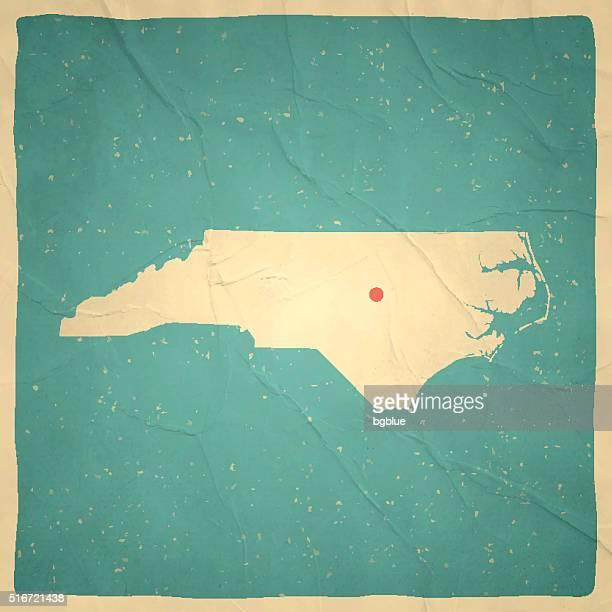 north carolina map on old paper - vintage texture - north carolina us state stock illustrations