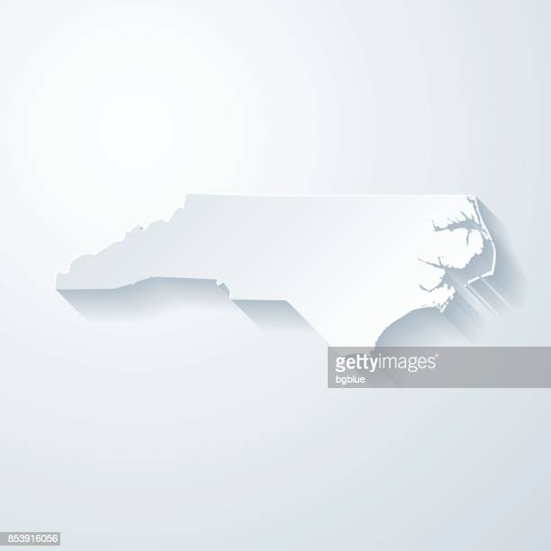 north carolina map with paper cut effect on blank background - north carolina us state stock illustrations