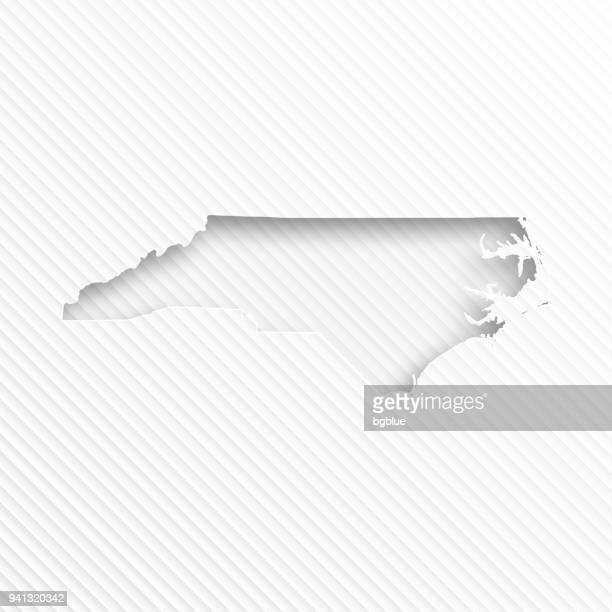 North Carolina map with paper cut on abstract white background