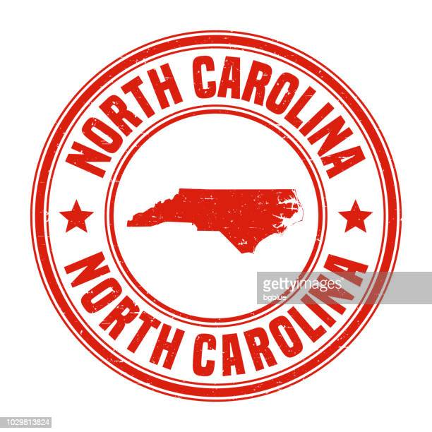 north carolina - red grunge rubber stamp with name and map - north carolina us state stock illustrations
