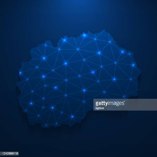 north macedonia map network - bright mesh on dark blue background - macedonia country stock illustrations
