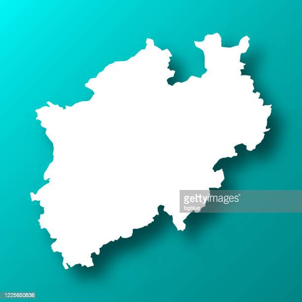 north rhine-westphalia map on blue green background with shadow - north rhine westphalia stock illustrations