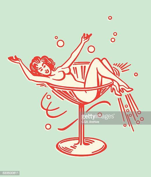ilustraciones, imágenes clip art, dibujos animados e iconos de stock de mujer desnuda en el vaso de martini - mujer desnuda