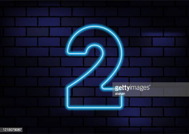 number 2 sign blue neon light on dark brick wall - number 2 stock illustrations