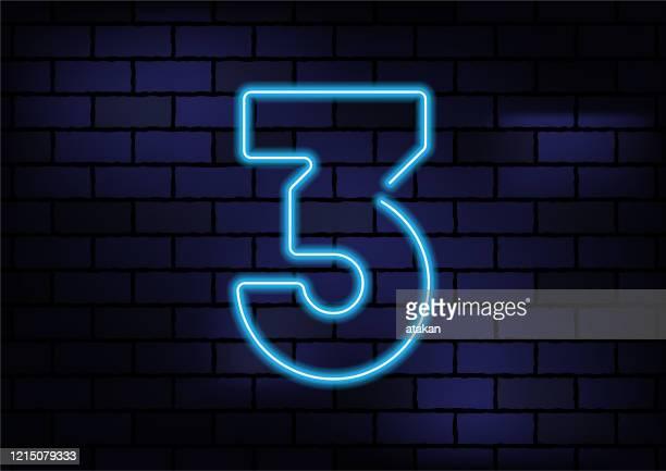 number 3 sign blue neon light on dark brick wall - number 3 stock illustrations