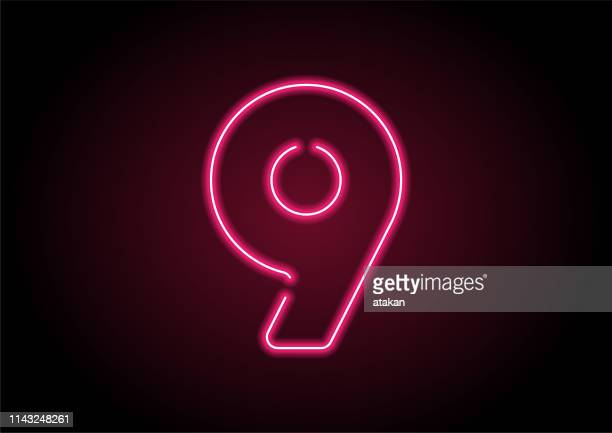number 9 red neon light on black wall - number 9 stock illustrations