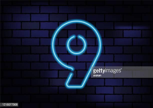 number 9 sign blue neon light on dark brick wall - number 9 stock illustrations