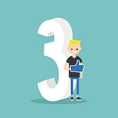 Number three concept: young smiling boy standing near the number Three.