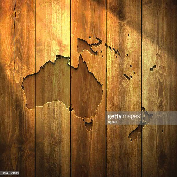 Oceania Map on lit Wooden Background
