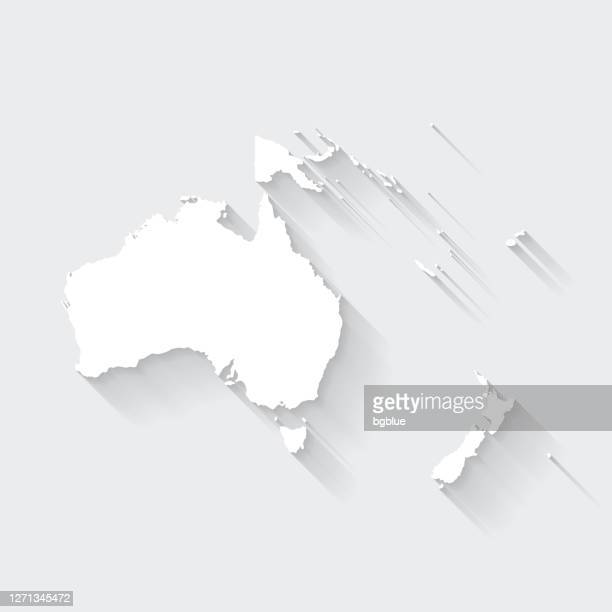 oceania map with long shadow on blank background - flat design - oceania stock illustrations