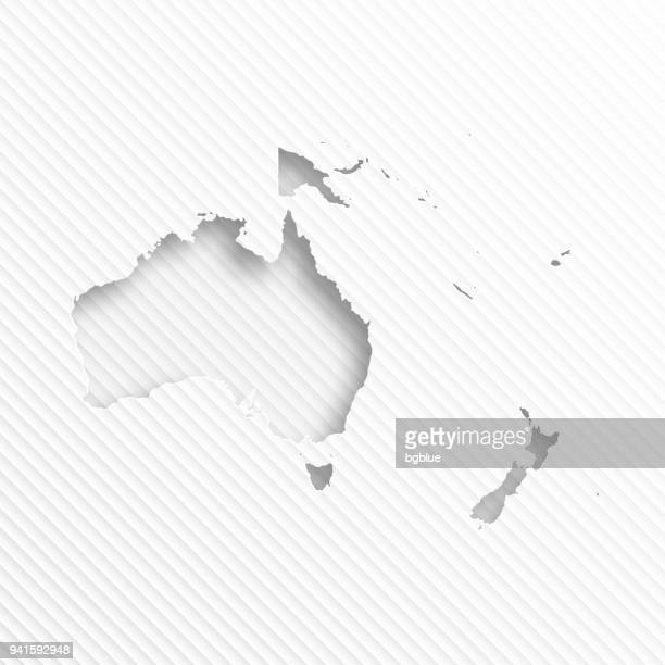 oceania map with paper cut on abstract white background - new caledonia stock illustrations