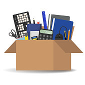 Office accessories in a cardboard box isolated on a white background