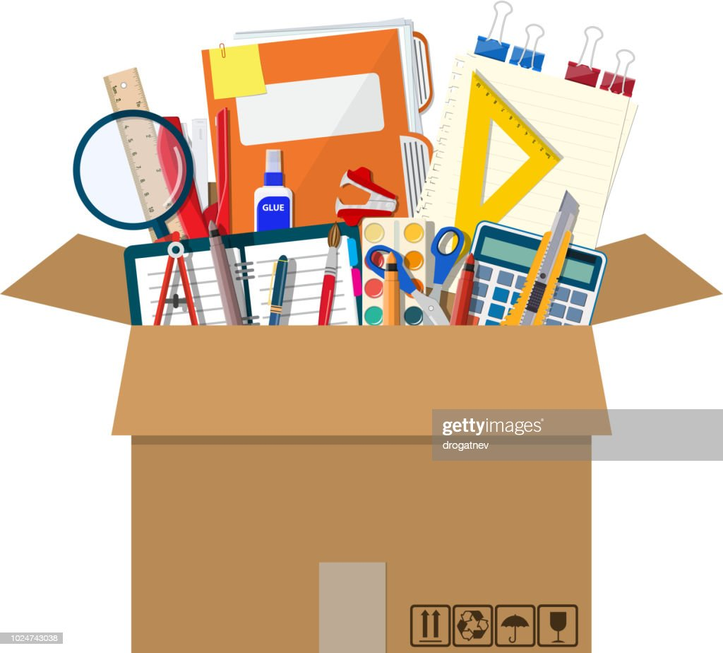 Office accessories in cardboard box.