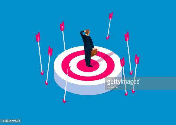 off-target, failure concept, desperate businessman standing on target without hit - failure stock illustrations