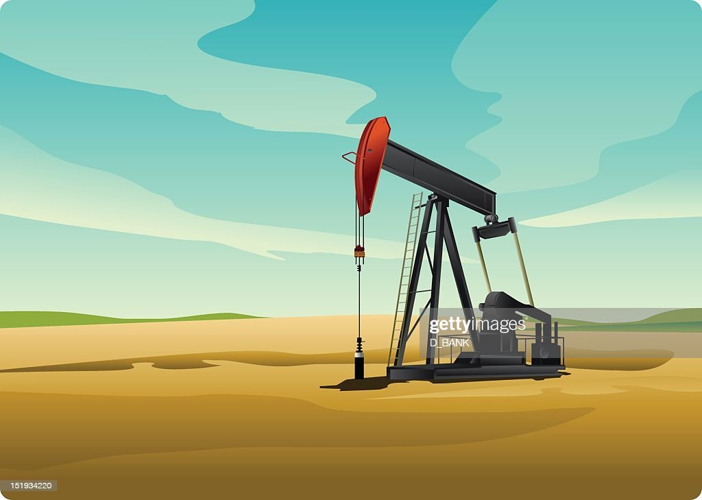 Oil pump on the yellow sand in the daylight