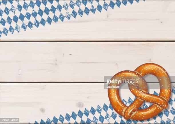 oktoberfest background [pretzel on the wooden boards] - pretzel stock illustrations, clip art, cartoons, & icons