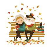 Old couple in love sitting on bench