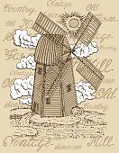 Old windmill with white clouds