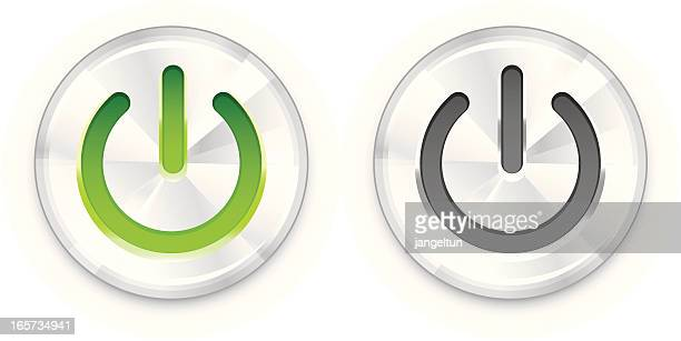 One green and one gray power button on white background