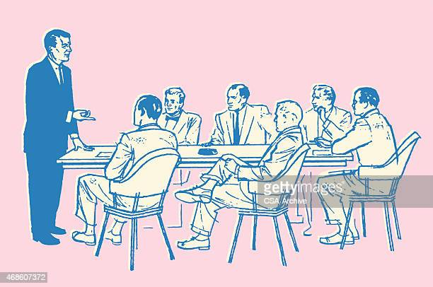 One Man Leading a Meeting at Work