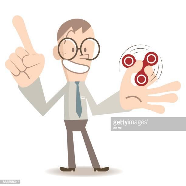 Ein lächelnder Mann mit Brille (junger Erwachsener, Geschäftsmann) zeigen, Unterricht, spielen, zappeln Spinner Spiel, Zeigefinger nach oben drehen
