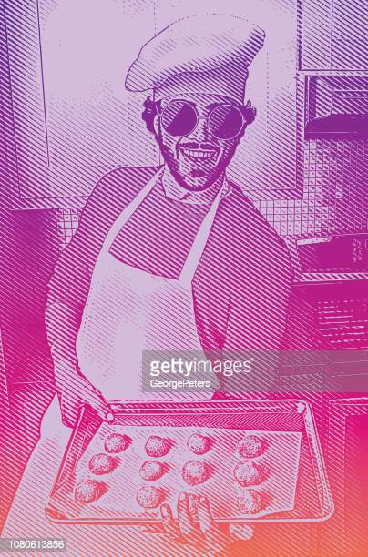 One young man baking cookies