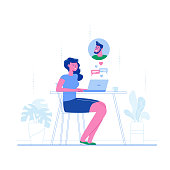 Online dating. A young girl chatting with a guy at a laptop. The concept of a romantic relationship on the internet, searching for a partner online, arrange a meeting.