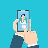 Online Doctor. Man holding smartphone