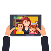 Online video conference call with mother and two kids. Hands holding tablet computer. Flat style vector