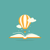Open book with air balloon and clouds