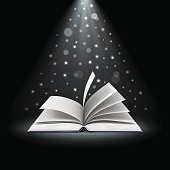 open book with magic lights