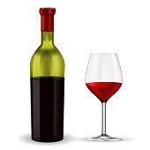 Open bottle of red wine with glass