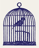 Open brass birdcage and bird