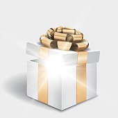 Open gift box with shiny light