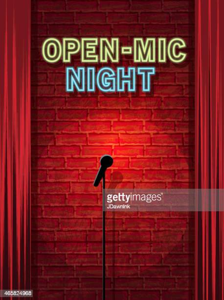 Open mic Night stage with neon sign and brick wall