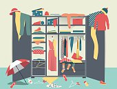 Open wardrobe. White closet with untidy clothes, shirts