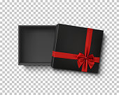 Opened black empty gift box with red ribbon.
