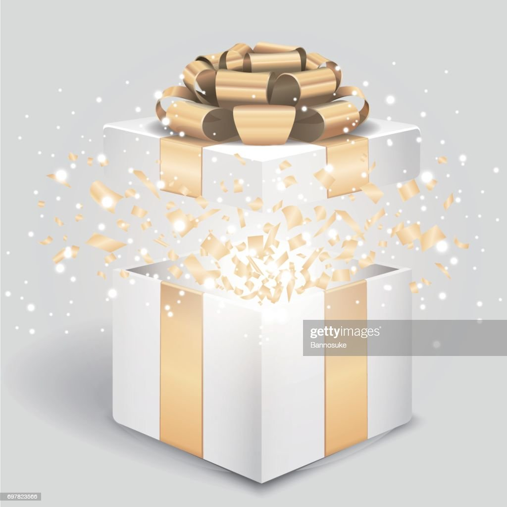 Opened gift box with gold bow and confetti