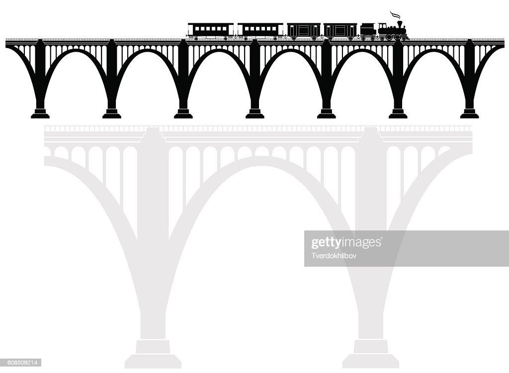 Openwork arch concrete bridge with a steam locomotive. Transport infrastructure