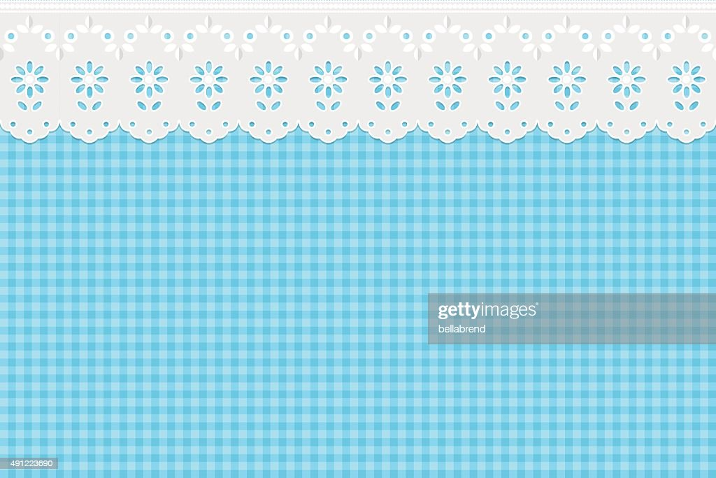 Openwork curtain drapery on a blue checkered pattern background.