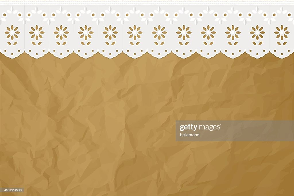 Openwork curtain drapery on a crumpled paper brown background.