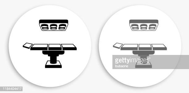 手術台黒と白の丸いアイコン - 手術台点のイラスト素材/クリップアート素材/マンガ素材/アイコン素材