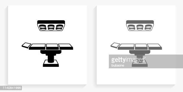 手術台黒と白の四角アイコン - 手術台点のイラスト素材/クリップアート素材/マンガ素材/アイコン素材