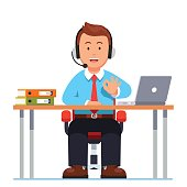 Operator of call center working sitting at desk