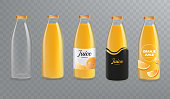 Orange juice bottle mockup. Vector glass bottle mock up isolated on transparent background. Design of labels for juice. Vector eps 10.